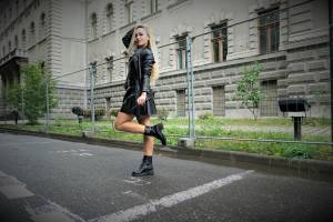 BLACK LEATHER SKIRT BLACK LEATHER JACKET AND BLACK LEATHER BOOTS